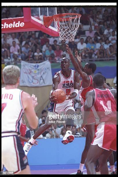 Guard Michael Jordan of the United States moves the ball during a game against Angola at the Olympic Games in Barcelona, Spain. Mandatory Credit:...