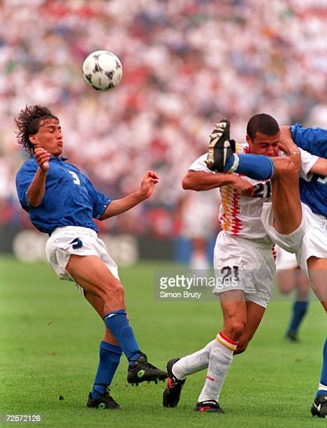 Antonio Benarrivo of Italy heads the ball as Luis Enrique of Spain during their Quarter Final match in the 1994 World Cup at Foxboro Stadium Foxboro...