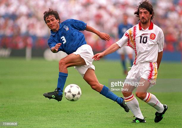 Antonio Benarrivo of Italy kicks the ball as Jose Maria Bakero of Spain challenges him during their quarter final World Cup match at Foxboro Stadium...