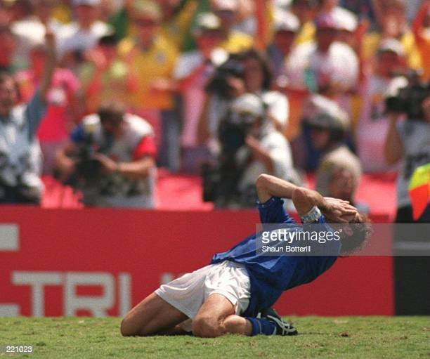 FRANCO BARESI OF ITALY DROPS TO HIS KNEES IN DESPAIR AFTER HE MISSED ITALY