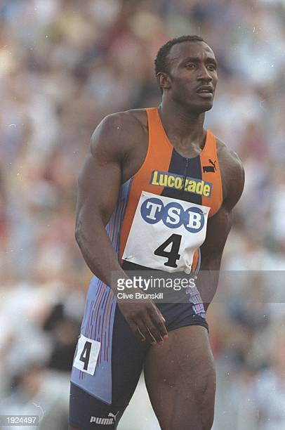 Linford Christie of Great Britain holds his Hamstring following the 100 metres event during the London Grand Prix Christie finished in second place...