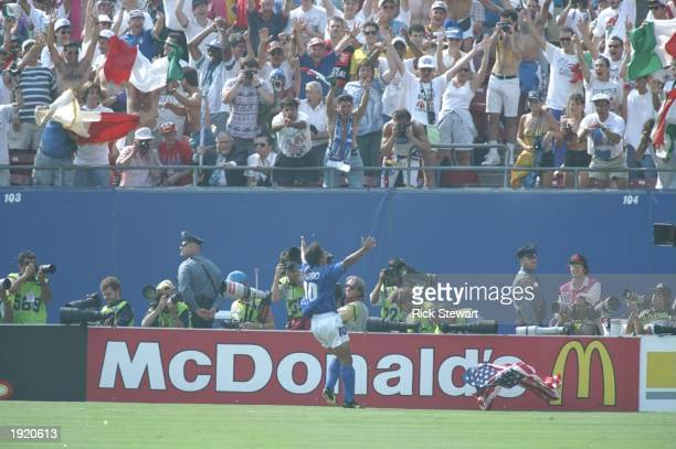 Robert Baggio of Italy celebrates with the crowd after scoring during the World Cup semi-final against Bulgaria at the Giants Stadium in New York,...