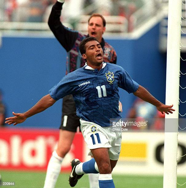 ROMARIO OF BRAZIL CELEBRATES AFTER SCORING THE OPENING GOAL AS DUTCH GOALKEEPER ED DE GOEJ APPEALS FOR AN OFF SIDE CALL DURING 1994 WORLD CUP FINALS...