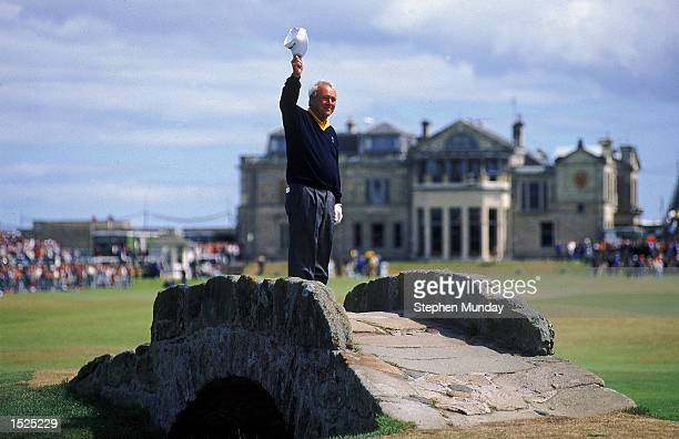 Arnold Palmer of the USA waves to the crowd from the Swilken Bridge on the 18th hole during the second round of the British Open at St Andrews in...