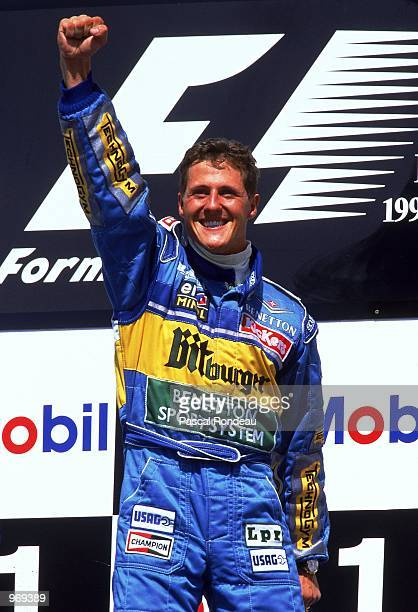 Benetton driver Michael Schumacher of Germany celebrates his win on the podium after the German Formula One Grand Prix held in Hockenheim Germany...