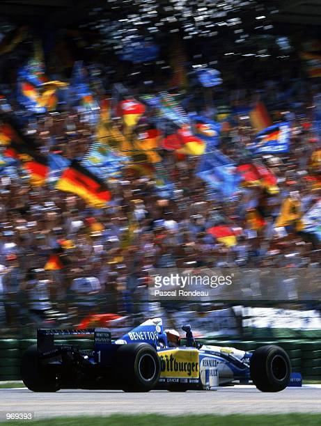 Benetton driver Michael Schumacher of Germany celebrates his win after the German Formula One Grand Prix held in Hockenheim Germany Mandatory Credit...