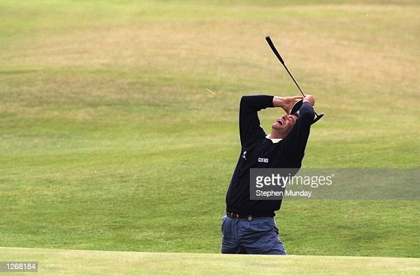 Costantino Rocca of Italy celebrates after holing a birdie putt on the 18th to force a playoff during the British Open at St Andrews Golf Club in...