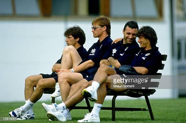 Gianfranco Zola Luigi Appolini Hristo Stoichkov and Antonio Benarrivo of Parma AC relax on a bench before a Friendly match against Rovereto at the...