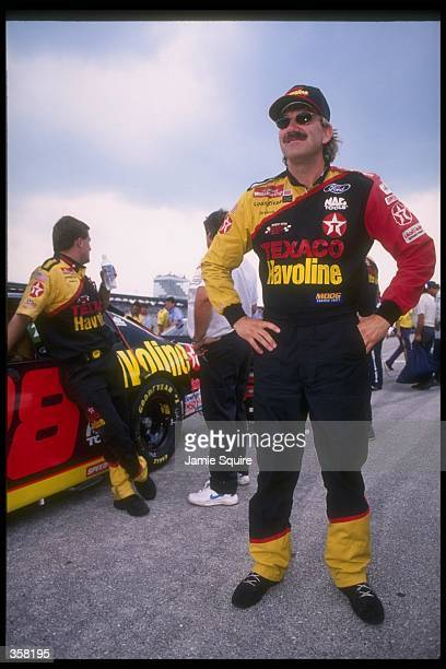 NASCAR driver Dale Jarrett stands with his Texaco Havoline car for the Nascar Die Hard 500 at the Talladega Superspeedway in Talladega Alabama...