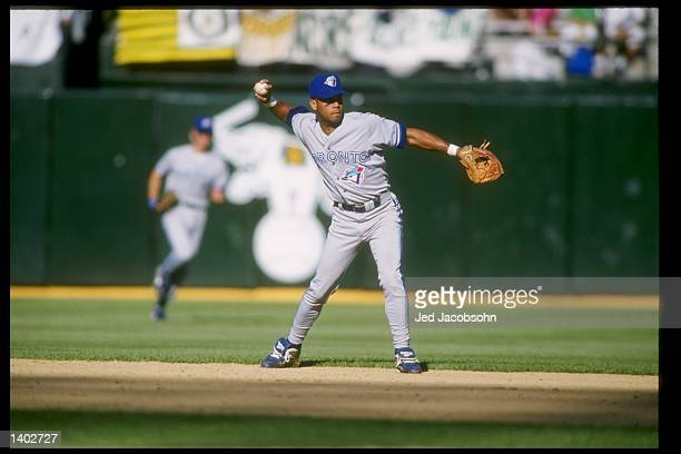 Second baseman Roberto Alomar of the Toronto Blue Jays throws the ball during a game against the Oakland Athletics at the Oakland Coliseum in Oakland...