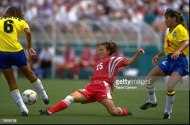 Chinese player tries to tackle the Brazilian during the Womens Football event at the Centennial Olympic Games in Atlanta, Georgia. China beat Brazil...