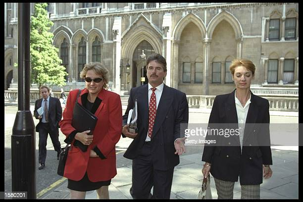 Allan Lamb arrives at cout with wife Lindsay and Kathy Botham during the libel case in the high court between Ian Botham and Imran Khan Mandatory...