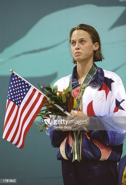 Amanda Beard of the USA celebrates on the podium after winning the silver medal in the women''s 100m breast stroke during the 1996 Olympic Games at...