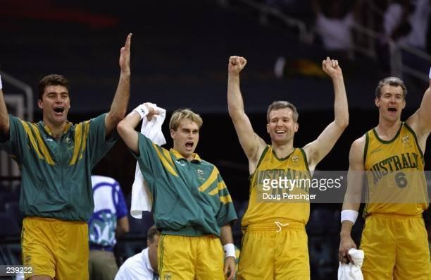 Australian Players Mark Bradtke Shane Heal Andrew Gaze and Scott Fisher celebrate during the Australia v Greece match at the 1996 Centennial Games at...