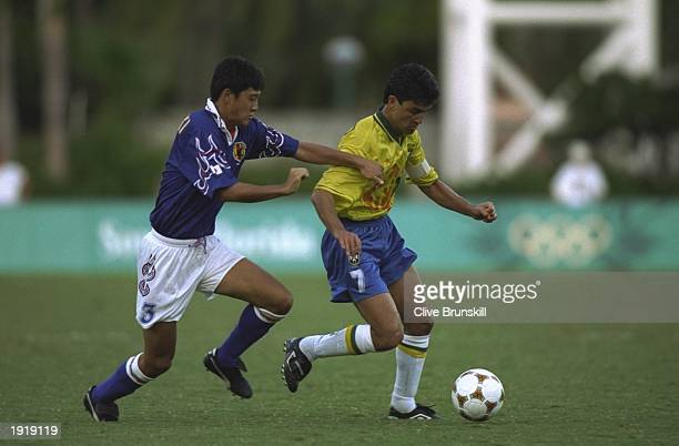 Bebeto of Brazil goes past Hideto Suzuki of Japan during the Football event at the Centennial Olympic Games in Atlanta, Georgia. Brazil lost 1-0. \...
