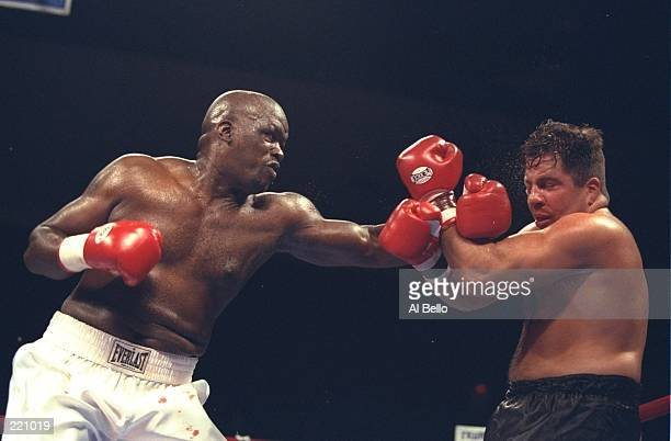 Buster Douglas delivers a blow to the head of Tony La Rosa during the Buster Douglas v Tony La Rosa fight at the Trump Taj Mahal in Atlantic City New...