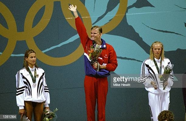 Claudia Poll of Costa Rica center wins the gold medal in the women's 200m breastroke at the Georgia Tech Aquatic Center at the 1996 Centennial...