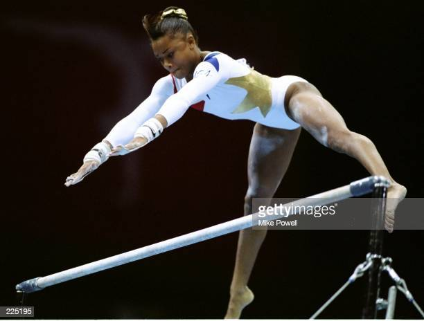Dominique Dawes of the USA in action in the womens individual all around final at the Georgia Dome at the 1996 Centennial Olympic Games in Atlanta...