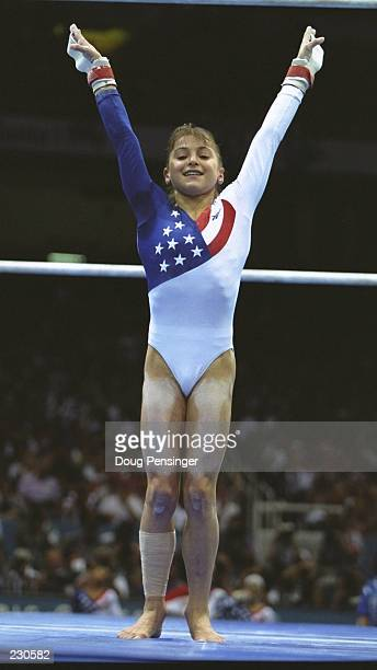 Dominique Moceanu of the USA finishes her parallel bars routine in the team event at the Georgia Dome at the 1996 Centennial Olympic Games in Atlanta...