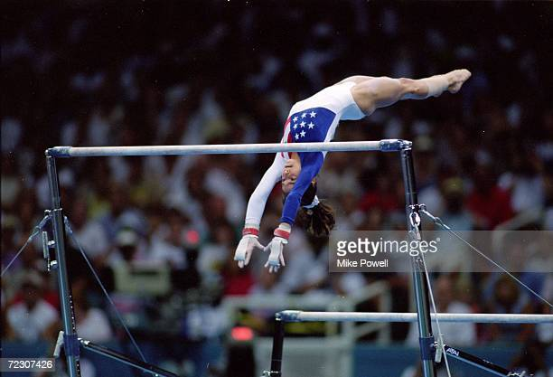 Dominique Moceanu of the USA flys over the bar during her routine at the Georgia Dome in the 1996 Olympic Games in Atlanta Georgia Mandatory Credit...