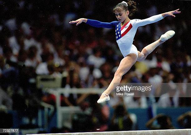 Dominique Moceanu of the USA leaps during the Women's Beam event at the Georgia Dome in the 1996 Olympic Games in Atlanta Georgia