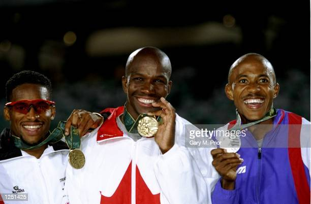 Donovan Bailey of Canada center wins the gold medal in the men's 100m at the Olympic Stadium at the 1996 Centennial Olympic Games in Atlanta Georgia...