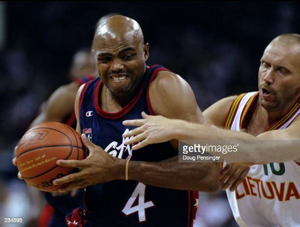 Forward Charles Barkley left of the Dream Team struggles to keep the ball from Rimas Kurtinaitis of Lithuania right during the USA v Lithuania...