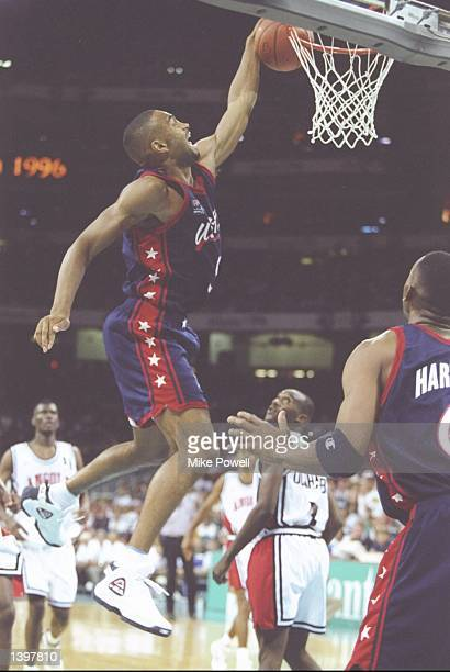Forward Grant Hill of the USA slam dunks the ball during a game against Angola during the Olympic Games at the Georgia Dome in Atlanta Georgia...