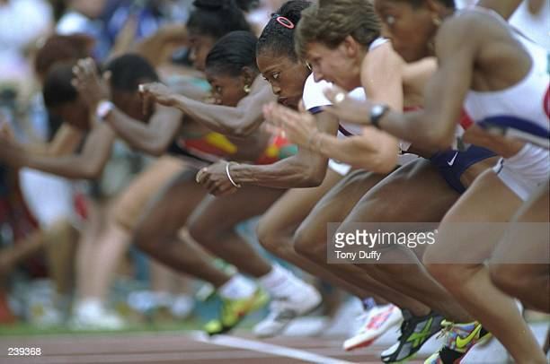 Gail Dervers of the USA at the start of the womens 100 metre heats at the Olympic Stadium at the 1996 Centennial Olympic Games in Atlanta Georgia...