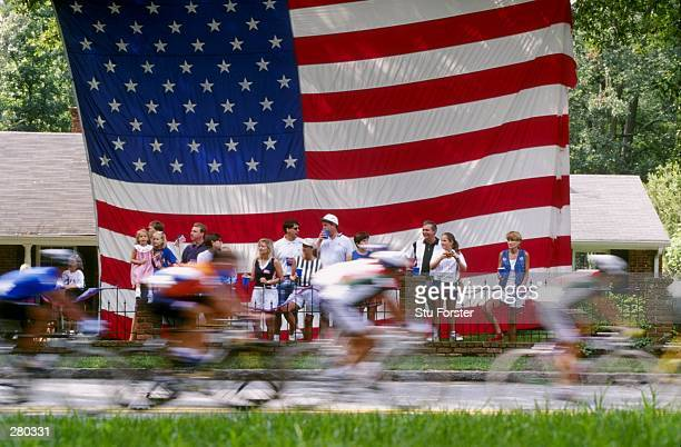 General view of the mens road race as the peleton streams past the Stars & Stripes at the 1996 Centennial Olympic Games in Atlanta, Georgia.