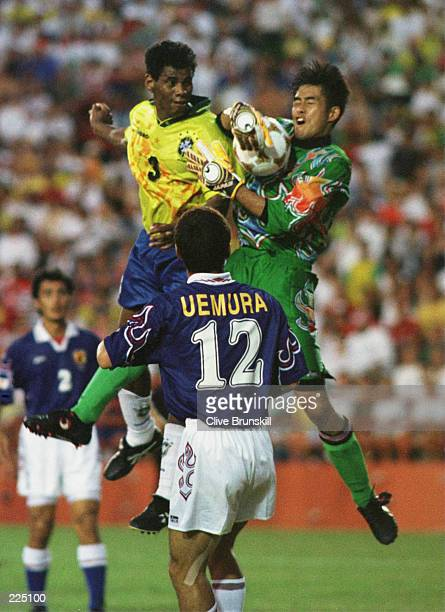 Goalkeeper Yoshikatsu Kawaguchi makes a save from a Brazilian forward at the Orange Bowl Stadium Miami in the 1996 Centennial Olympic Games Japan...