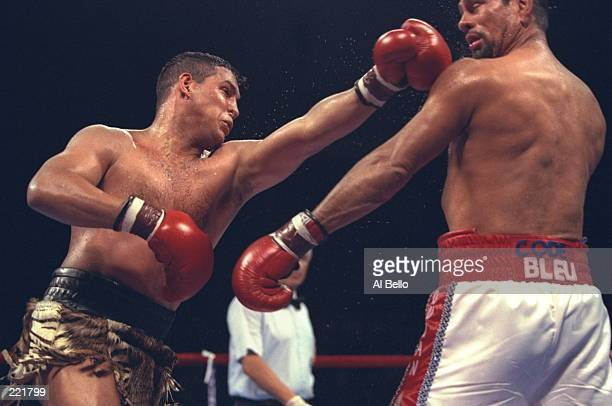 """Hector Camacho delivers a blow to the head of Roberto Duran during the Hector """"Macho"""" Camacho v Roberto Duran bout at the Trump Taj Mahal in Atlantic..."""