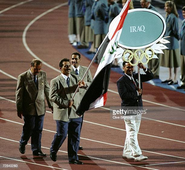 Iraqi wrestler Raed Ahamed carrying the flag for Iraq during the Opening Ceremony of the 1996 Centennial Games in Atlanta, Georgia.