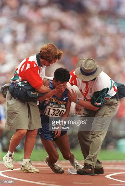 Jefferson Perez of Ecuador collapses after crossing the line to win gold in the mens 20km walk during the 1996 Centennial Games at the Olympic...