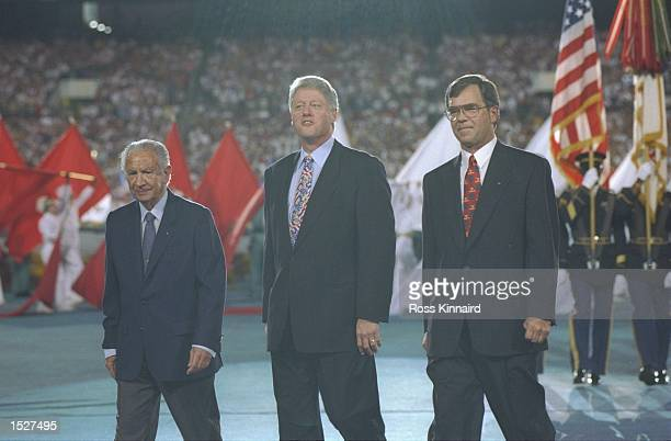 Juan Antonio Samaranch left President Clinton and Billy Payne right President of ACOG during the Opening Ceremony of the 1996 Olympic Games in...