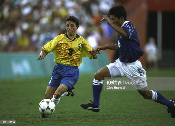 Juninho of Brazil takes on Toshihiro Hattori of Japan during the Football event at the Centennial Olympic Games in Atlanta, Georgia. Japan beat...