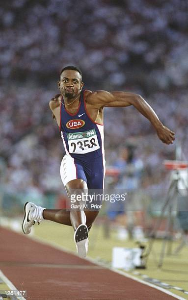 Kenny Harrison of the USA in action on his fourth jump during the men's triple jump at the Olympic Stadium at the 1996 Centennial Olympic Games in...