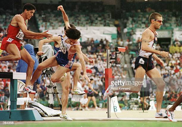 Kieth Cullen of Great Britain stumbles over the water jump in the second round of the men''s 3000 meter steeplechase in the Centennial Olympic Games...
