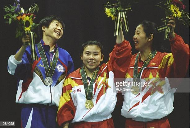 Medallists for the womens singles table tennis L to R Jing Cheng of Taipei silver Yaping Deng gold Hanmg Qiao of China bronze at the Georgia World...