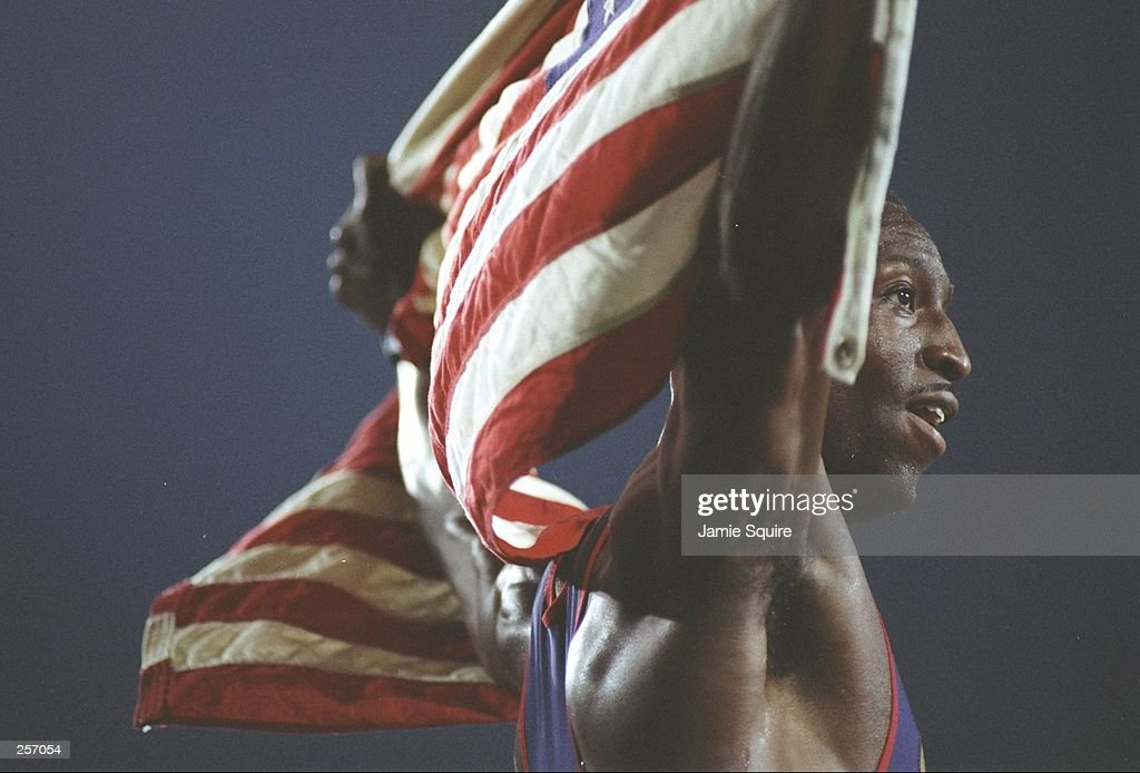 Michael Johnson holds an American flag after winning the 400 meters at the Olympic Games at Olympic Stadium in Atlanta, Georgia.
