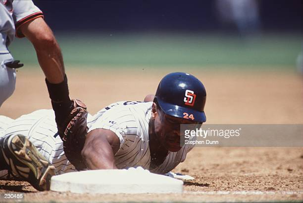 Outfielder Rickey Henderson of the San Diego Padres slides into third base during the Padres'' 8-4 win over the San Francisco Giants at Jack Murphy...