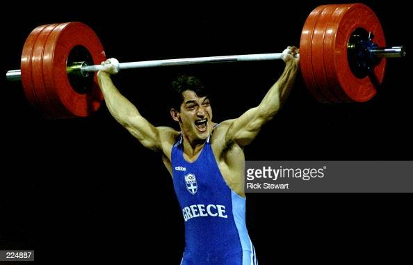 Pyrros Dimas of Greece wins gold in the 83kg weightlifting ...