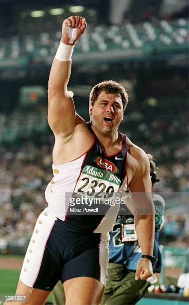 Randy Barnes of the USA celebrates after throwing the gold medalwinning toss in the men's shot put at Olympic Stadium in Atlanta Georgia Mandatory...