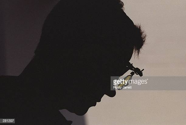 Silhouette of Ralf Schumann of Germany during the mens 25m rapid pistol event at the Wold Creek Complexr at the 1996 Centennial Olympic Games in...