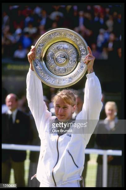 Steffi Graf of Germany once again lifts the womens singles trophy after her straight sets victory over Arantxa Sanchez Vicario of Spain during the...