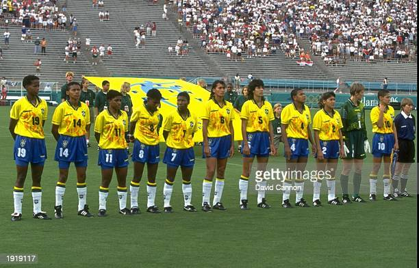 The Brazilian team line up for the national anthem during the Womens Football event at the Centennial Olympic Games in Atlanta Georgia Brazil lost 32...