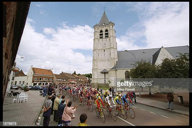 The peleton cruises through the French countryside during the 195 kilometre third stage from Wasquehal to Nogent sur Oise in the 83rd Tour de France...