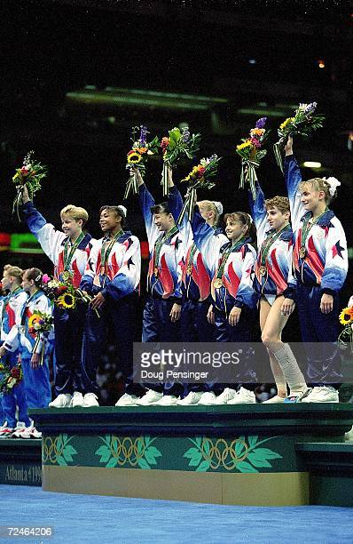 The US Women's Team stand on the winnersblock and hold up their flowers after the Women's Team Optional at the Georgia Dome in the 1996 Olympic Games...
