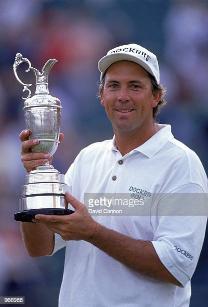 Tom Lehman of the USA holds aloft the Claret Jug after winning the British Open played at Royal Lytham St Annes Golf Club in Lancashire England...
