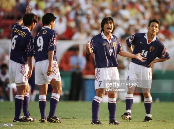 Toshihiro Hattori Shoji Jo team captain Masakiyo Maezono and Hidetoshi Nakata of Japan during the match against Brazil at the Orange Bowl Stadium...